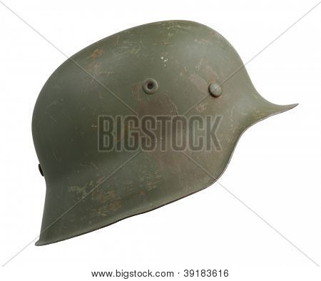 A German World War Two (Stahlhelm M1942) military helmet. The M1942 design was a result of wartime demands. The rolled edge on the shell was eliminated to simplify production.