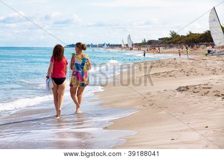 VARADERO,CUBA-NOVEMBER 3:Foreign tourists walking at the beach November 3,2012 in Varadero.With 50 hotels and about 20 000 rooms,Varadero is the main destination for tourists visiting Cuba