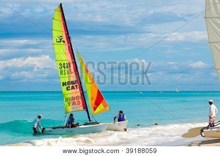 VARADERO,CUBA-NOVEMBER 3:Tourists sailing on a catamaran November 3,2012 in Varadero.With over a million visitors per year,Varadero is the destination of more than 40% of tourists visiting the island