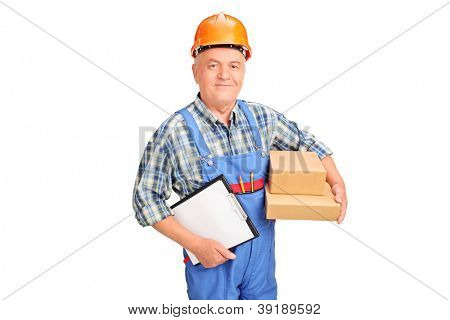 A male worker in uniform holding boxes and clipboard isolated against white background