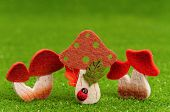 stock photo of shroom  - Artificial small mushrooms on artificial green grass - JPG