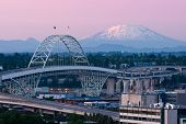 Alpenglow on Mount St. Helens and Mt. Rainier with Portland's Fremont Bridge in the foreground