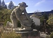 foto of gold mine  - This is a picture of the landmark gold miner panning for gold at Auburn California a historic gold mining city - JPG