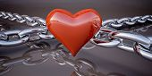 stock photo of glans  - Shiny red heart and a chain on a dark gray background - JPG