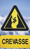 picture of crevasse  - Crevasse sign on snowy mountain  - JPG
