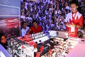 SUBANG JAYA - NOV 10: Unidentified students from Bahrain explain how remote controlled robots allow