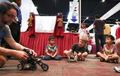 SUBANG JAYA - NOVEMBER 10: An unidentified robotics expert gets the visitors' attention with a motor