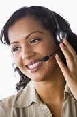 Middle Eastern Business Woman Using Headset