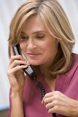 Consultant Phoning Client From Surgery With Good News