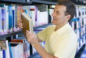 Man In Library With Book