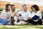 foto of motivation talk  - Adult students on lawn of school studying and talking - JPG