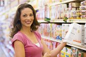 pic of grocery-shopping  - Woman shopping at a grocery store - JPG