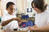 stock photo of tweeny  - Students in class with electronic project - JPG