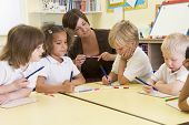 stock photo of subtraction  - Students in math class with teacher - JPG