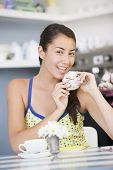Woman Eating Cake In Tea Room