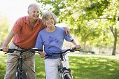 picture of senior-citizen  - Senior couple on bicycles - JPG