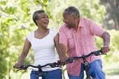 image of older men  - Senior couple on bicycles - JPG