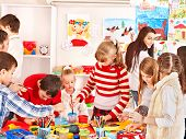 image of nursery school child  - Child painting at art school - JPG