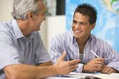 stock photo of half-dressed  - Teacher giving personal instruction to male student - JPG