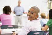foto of hair integrations  - Male student with other students in classroom - JPG