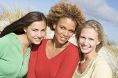 picture of young woman posing the camera  - Three women posing outdoors - JPG