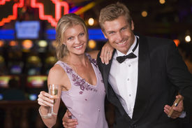 foto of slot-machine  - Couple in casino with cigar and champagne smiling  - JPG