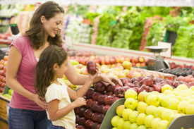 picture of mother child  - Woman and daughter shopping for apples at a grocery store - JPG