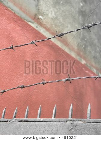 Rusty Barbed Wire And Spikes