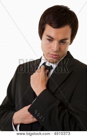 Man Fixing Tie