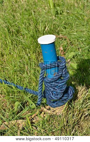 Blue mooring post with rope