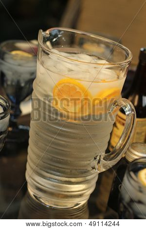 pitcher of water with lemon slices
