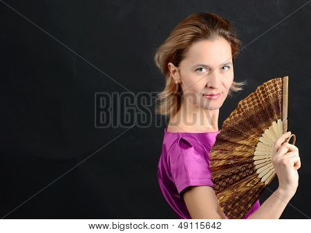 girl with a fan in her hand