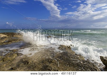 Waves Crashing Along The Rocky Shore