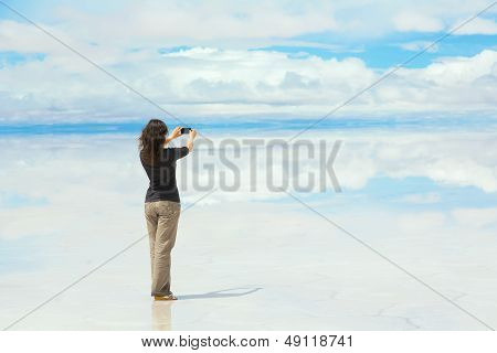 Girl taking pictures on mobile phone