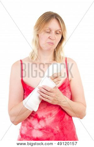 Mature Woman Looking Sadly At Her Bandaged Finger