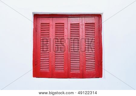 Red Shutters over Window