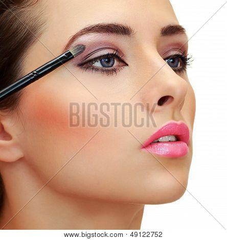 Eyes Makeup. Brush Applying Eye Shadows On Beauty Woman Face. Closeup