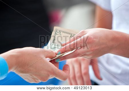 Women's Hands Exchange Money At Festival Vendor Booth