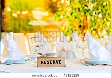 beautifully laid for supper table with a sign reserved