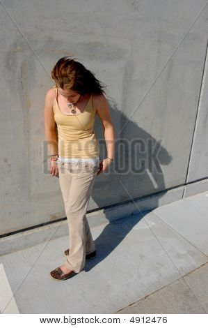 Teenage Girl Walking With Shadow