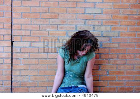 Sad Girl With Bowed Head