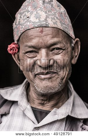 Portrait Of An Old Man With A Flower