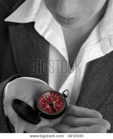 Business Woman With Compass In Her Hand