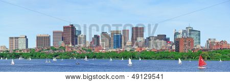 Boston Charles River panorama with urban skyline skyscrapers and sailing boat.