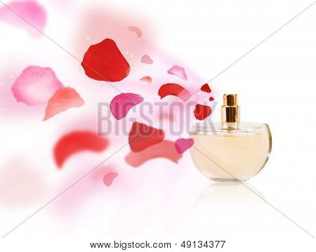 Perfume bottle spraying colorful rose petals