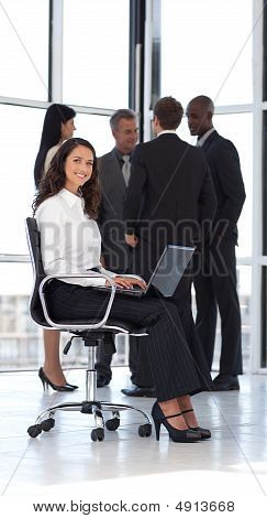 Young Attractive Woman In Office Working