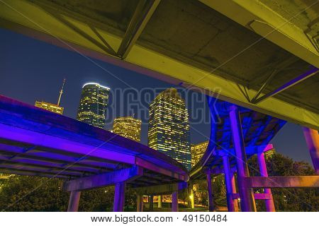 View On Downtown Houston By Night With Bridges In Colorful Light
