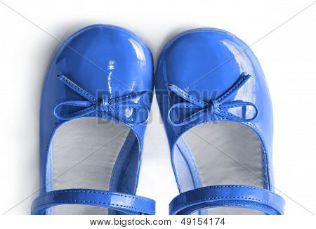 Blue patent leather shoes with bows on a white background