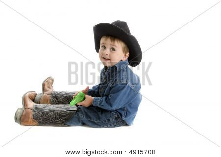 Toddler Cowboy With Dad's Boots And Squirt Gun