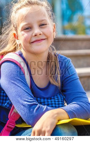 Portrait of a cute school aged girl